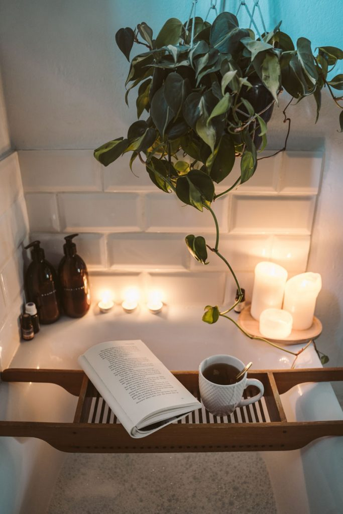relaxing bath setup with book and tea