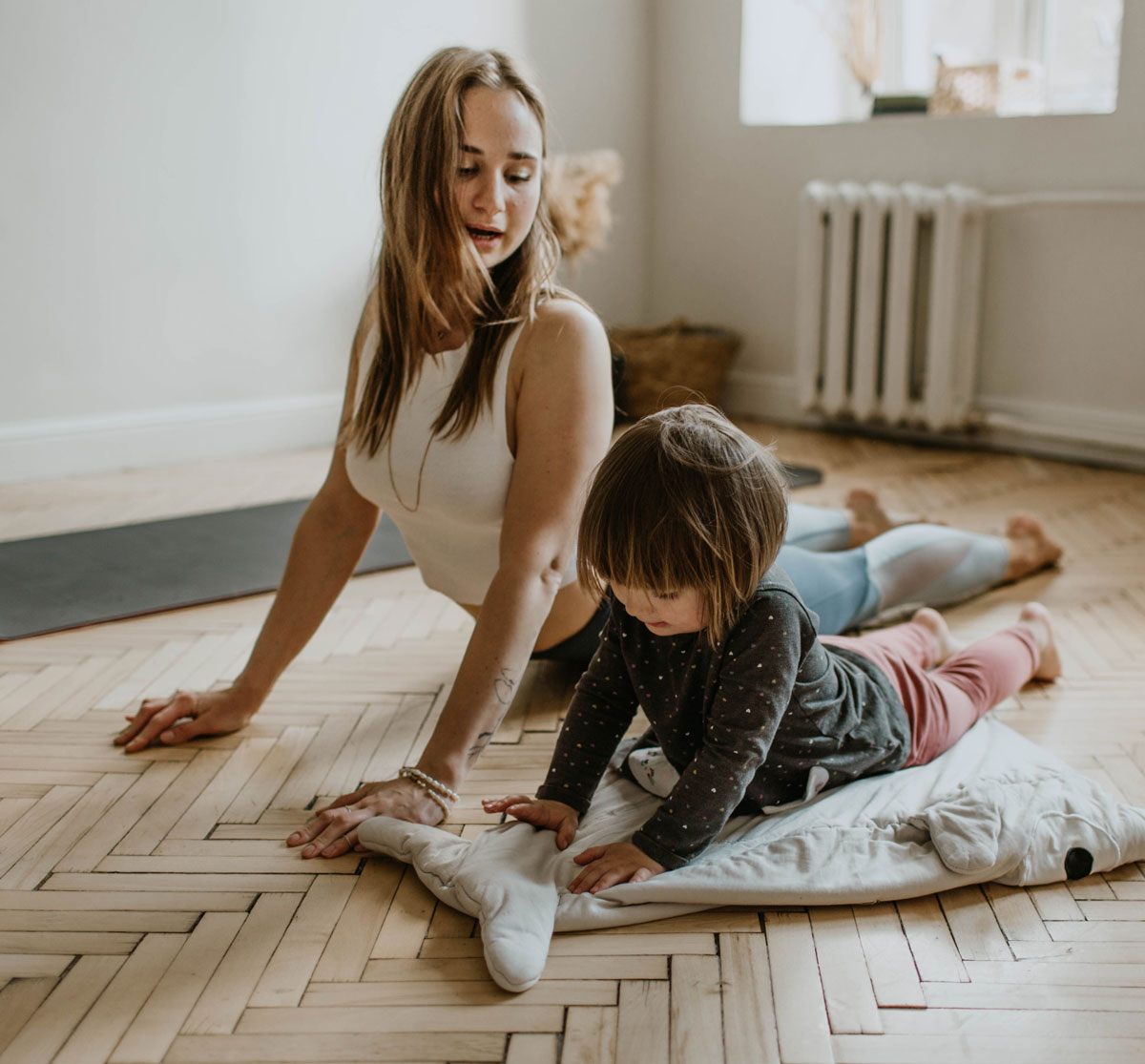 mother and child doing yoga together at home